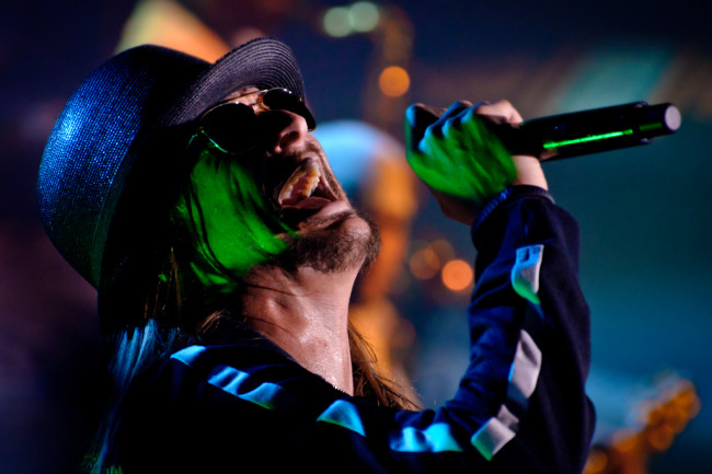 Kid Rock, singing, during his Bloomington, Illinois concert on March 28, 2013